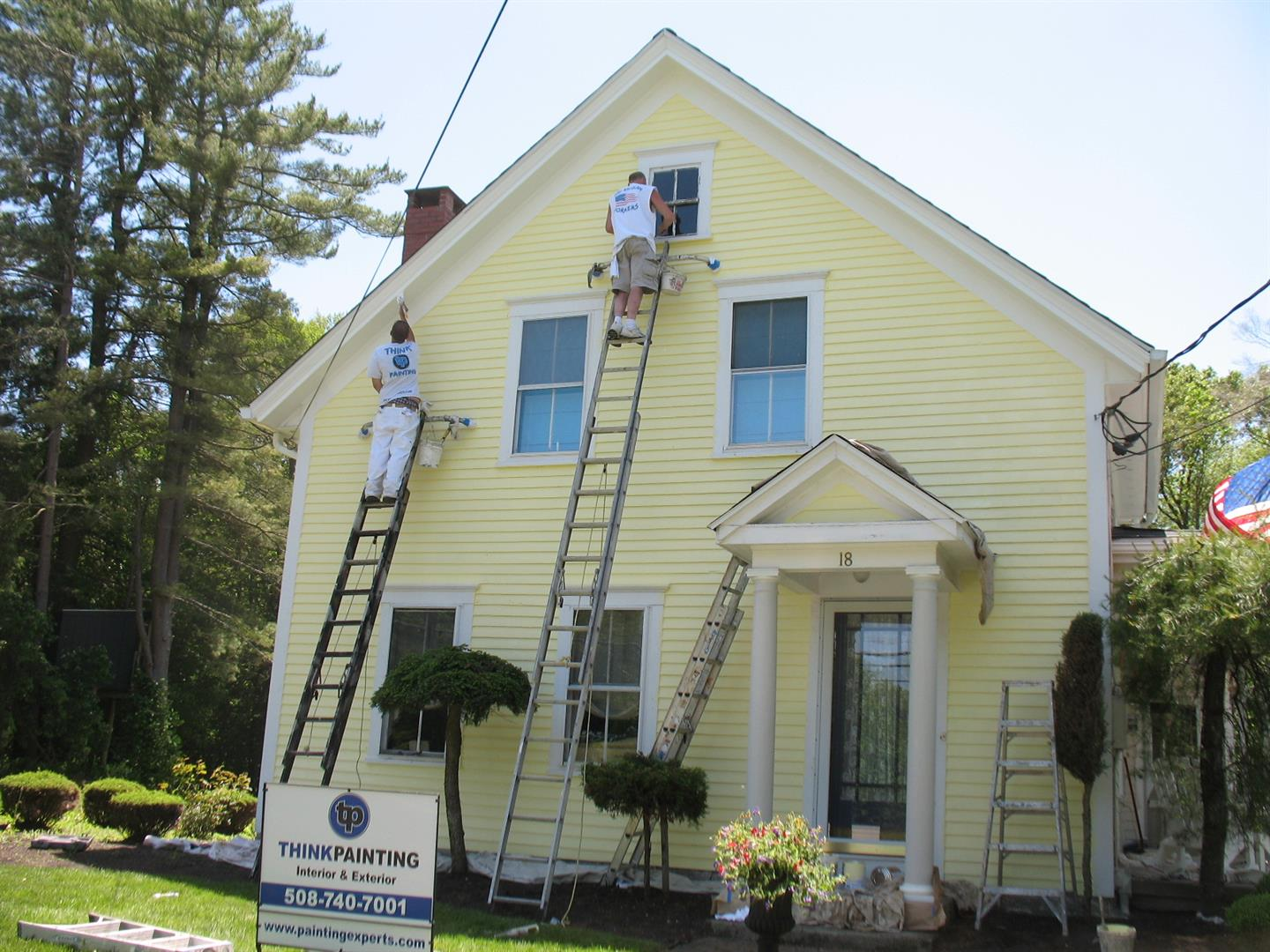 House painter painting the image kid has it - Painting the exterior of your house concept ...
