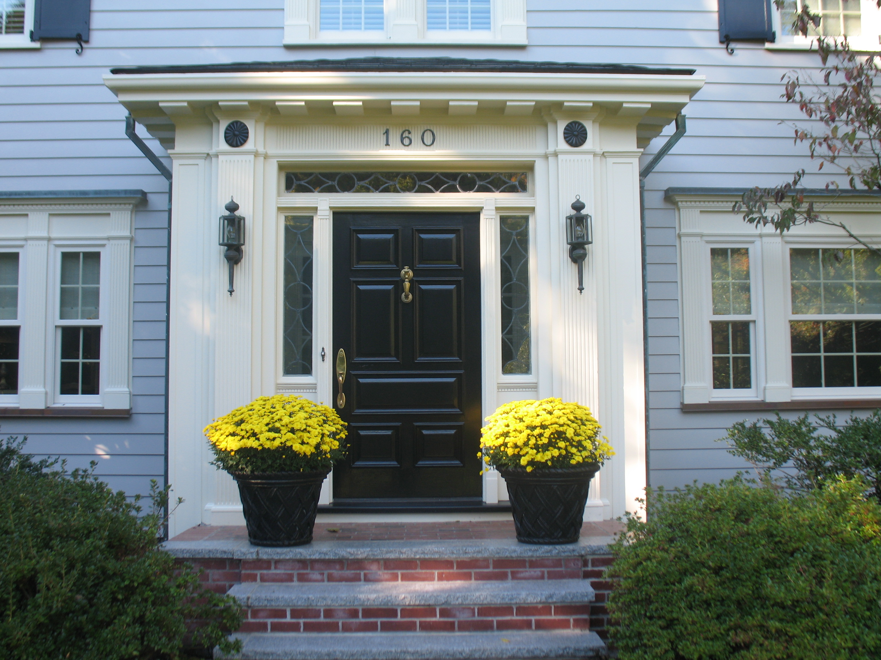 Front door repainting in massachusetts and rhode island for Black wooden front door